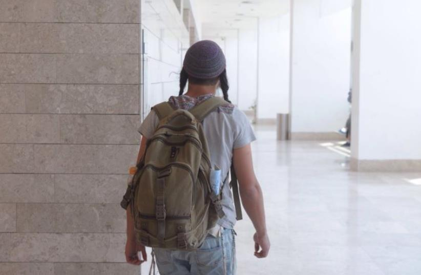 An indictment hearing was held at the Lod District Court for memebers of a suspected Jewish terror cell, April 25, 2016 (photo credit: AVSHALOM SASSONI)