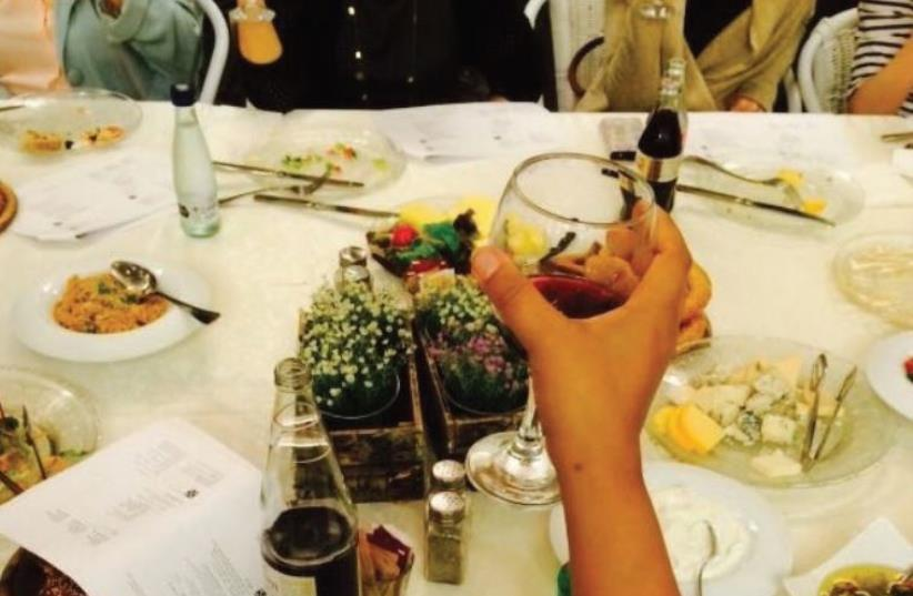 Raising a glass at the Turning the Tables Seder (photo credit: TTT)