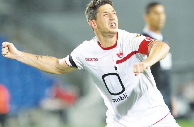 Hapoel Beersheba midfielder Maor Melikson celebrates after scoring his team's second goal in last night's 4-1 win over Hapoel Ra'anana in Netanya. (photo credit: DANNY MARON)