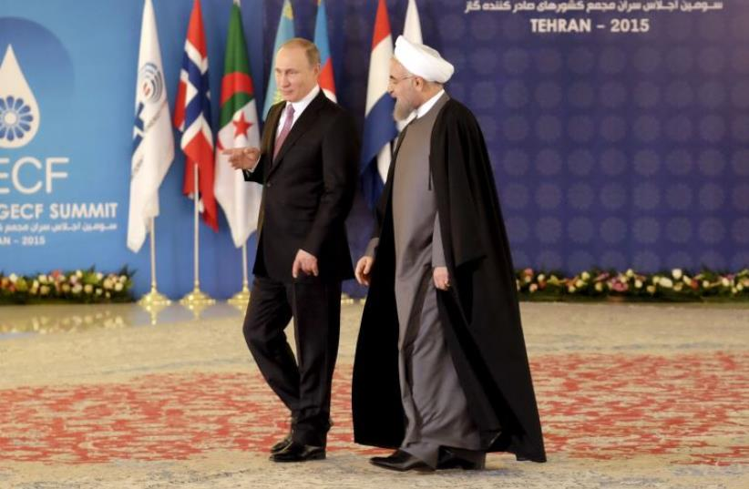 Iran's President Hassan Rouhani (R) walks with Russia's President Vladimir Putin before a meeting during the Gas Exporting Countries Forum (GECF) in Tehran, November 23, 2015 (photo credit: REUTERS)