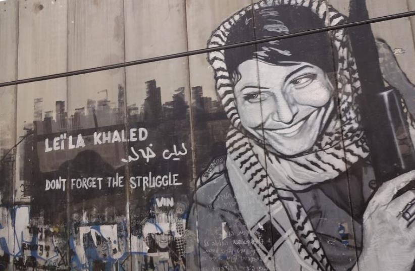 Graffiti depicting the PFPL plane hijacker Leila Khaled on the security barrier near Bethlehem (photo credit: Wikimedia Commons)