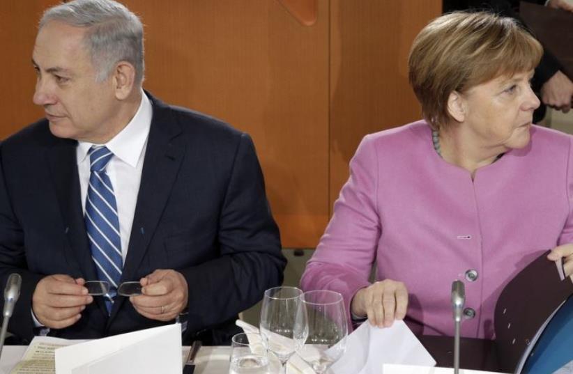 Prime Minister Benjamin Netanyahu (L) and German Chancellor Angela Merkel (photo credit: REUTERS)