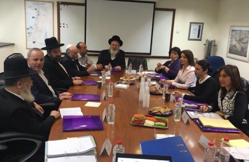 The nine members of the Appointments Committee for Rabbinical Judges convenes in Jerusalem (photo credit: COURTESY OFFICE OF MK REVITAL SWID)