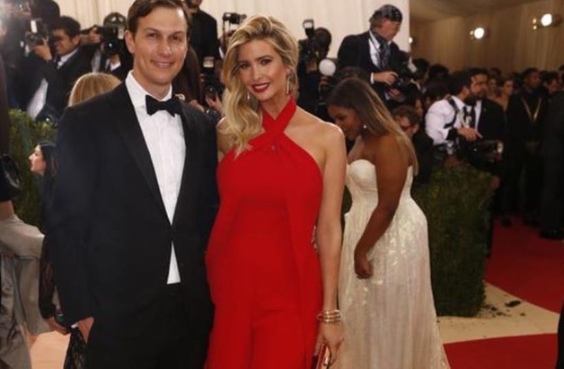 Ivanka Trump in Ralph Lauren and husband Jared Kushner  (photo credit: REUTERS/LUCAS JACKSON)