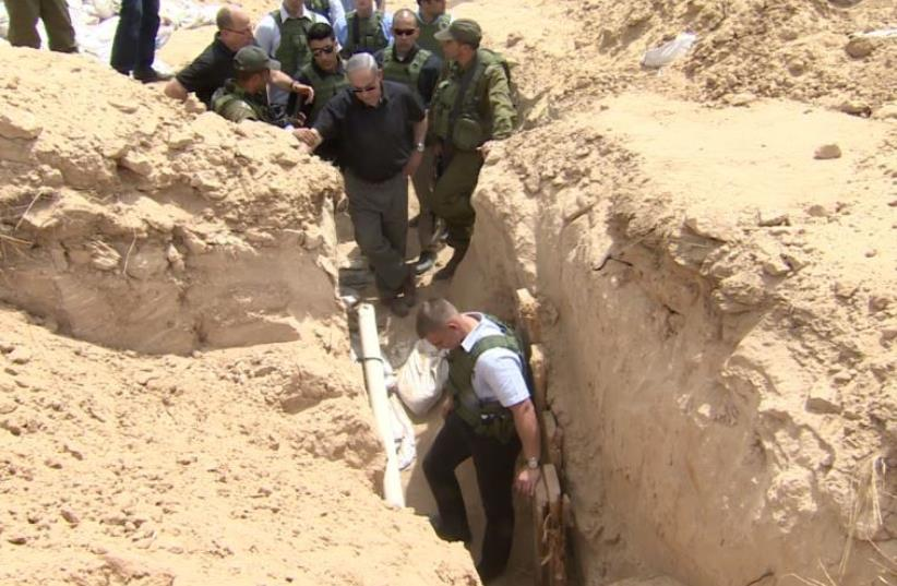 Netanyahu stands next to Hamas tunnel  (photo credit: screenshot)