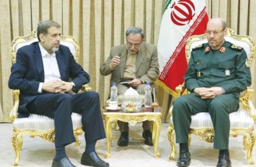 ISLAMIC JIHAD leader Ramadan Shalah (left) meets with Iranian Defense Minister Hossein Dehqan in Tehran on Tuesday (photo credit: IRANIAN MEDIA)