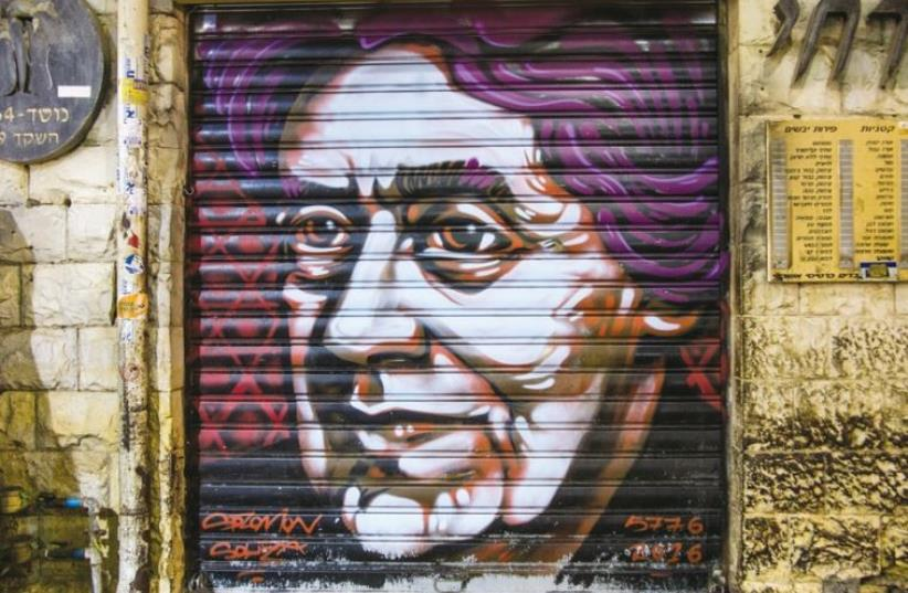 A spray-painted portrait of Henrietta Szold in Mahaneh Yehuda market, Jerusalem (photo credit: SARAH LEVI)