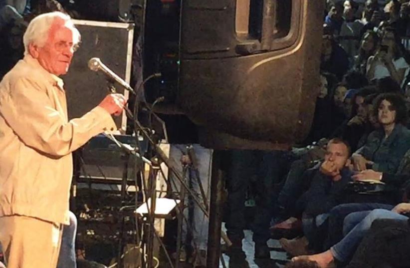 TUNISIAN HOLOCAUST SURVIVOR Yigal Halamit speaks to a crowd in Jerusalem's Mahaneh Yehuda market about the Holocaust in Tunisia on Wednesday night (photo credit: SETH J. FRANTZMAN)
