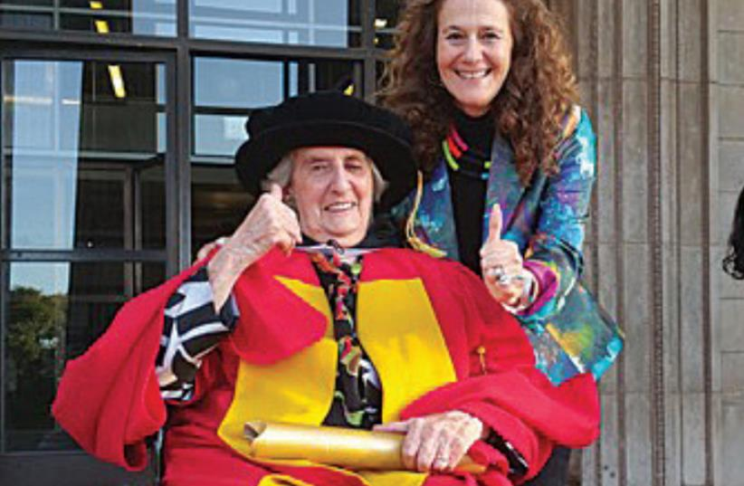ESMÉ BERMAN celebrates receiving her honorary doctorate on the steps of the University of the Witwatersrand with her daughter, Kathy, on March 30. (photo credit: Courtesy)