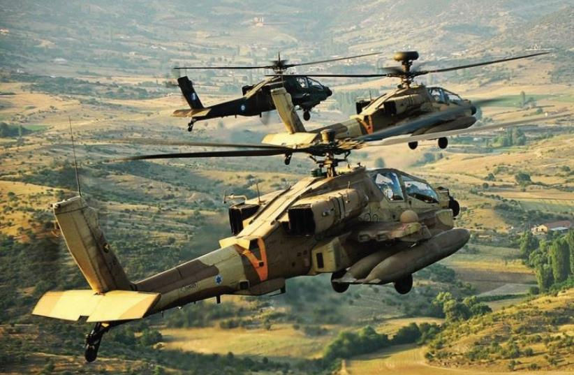 An Israel Air Force Apache helicopter lands across from a Greek mountain range during a joint Israel-Greece exercise with the Hellenic Air Force in October 2011 (photo credit: IAF)