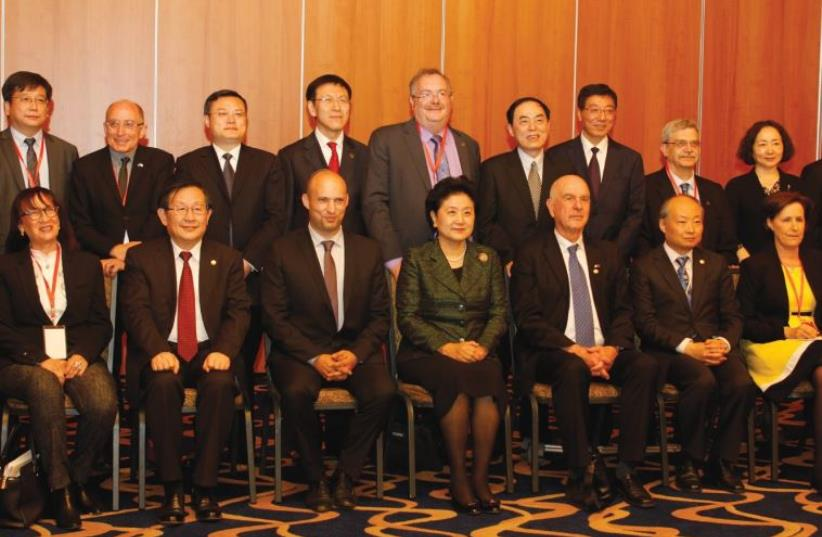 Education Minister Naftali Bennett (front row, third from left), Deputy Prime Minister of China Liu Iandong and Prof. Yaffa Zilbershats, chairman of the Planning and Budgeting Committee for Higher Education at an event last March in Jerusalem marking a bilateral series of agreements to promote acade (photo credit: Courtesy)