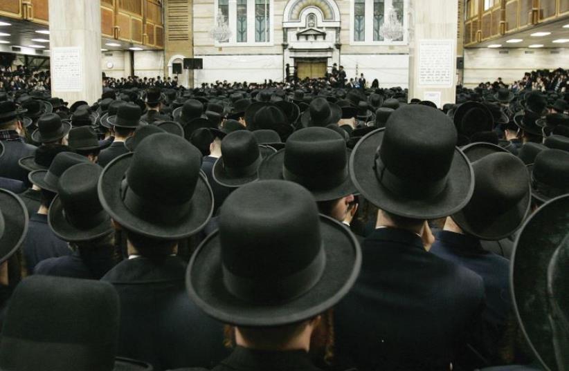 Satmar Hasidim in the Yetev Lev D'Satmar synagogue in the town of Kiryas Joel, New York (photo credit: REUTERS)
