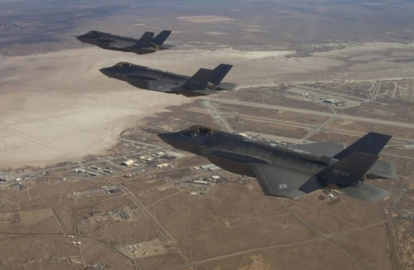 Three F-35 Joint Strike Fighters (rear to front) AF-2, AF-3 and AF-4, can be seen flying over Edwards Air Force Base (photo credit: REUTERS)