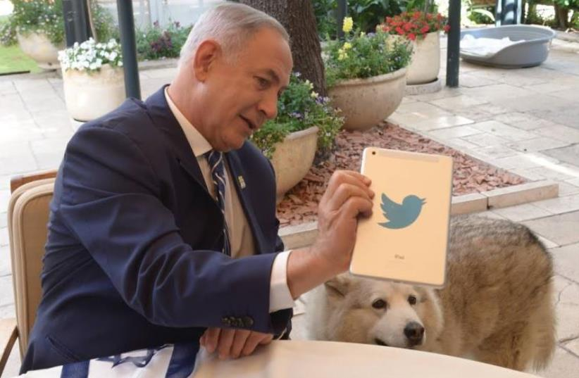 Prime Minister Benjamin Netanyahu answers questions on Twitter (photo credit: GPO/AMOS BEN GERSHOM)