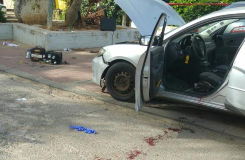 Scene of car bombing in Or Yehuda (photo credit: TAMIR ZEHARYA/MDA)