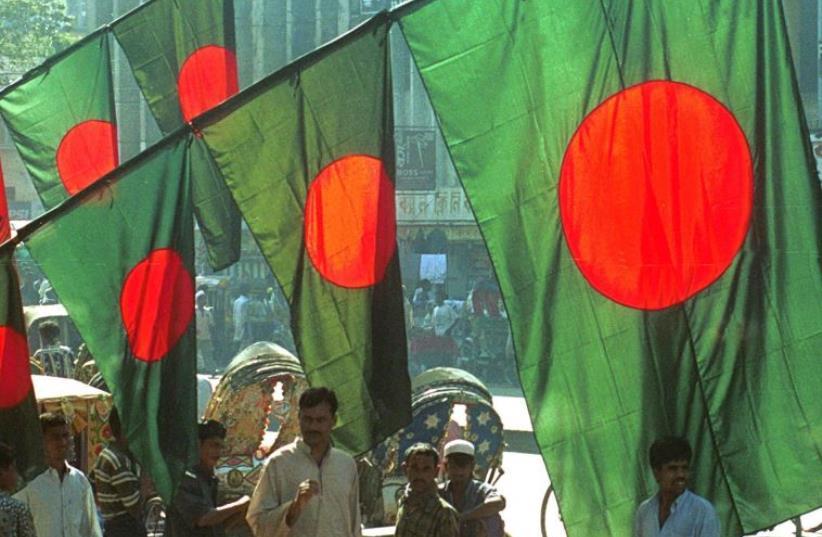 Vendors sell Bangladesh national flags in Dhaka (photo credit: REUTERS)