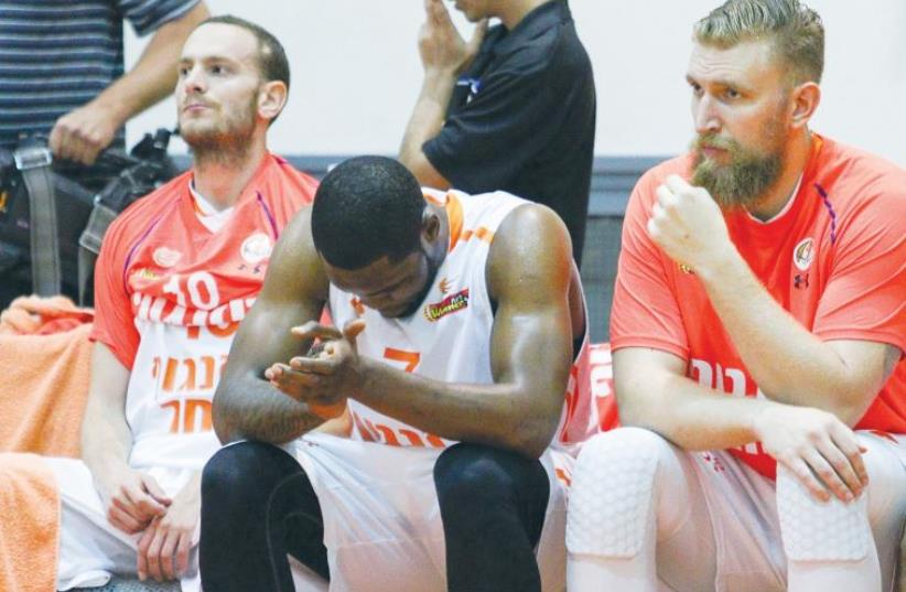 Ironi Ness Ziona players (from left) Yuval Naimi, Ivan Aska and Igor Nesterenko (photo credit: DANNY MARON)