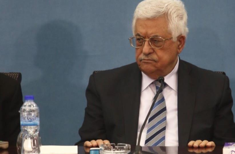 Palestinian Authority President Mahmoud Abbas meets Israeli delegation in Ramallah, May 17, 2016 (photo credit: MARC ISRAEL SELLEM/THE JERUSALEM POST)