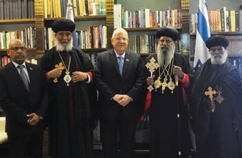 PRESIDENT REUVEN RIVLIN with Ethiopian Orthodox Church Patriarch Abune Mathias (second right), senior representatives of the Church and Ethiopian Ambassador Helawe Yosef (left). (photo credit: PRESIDENTIAL SPOKESPERSON OFFICE)