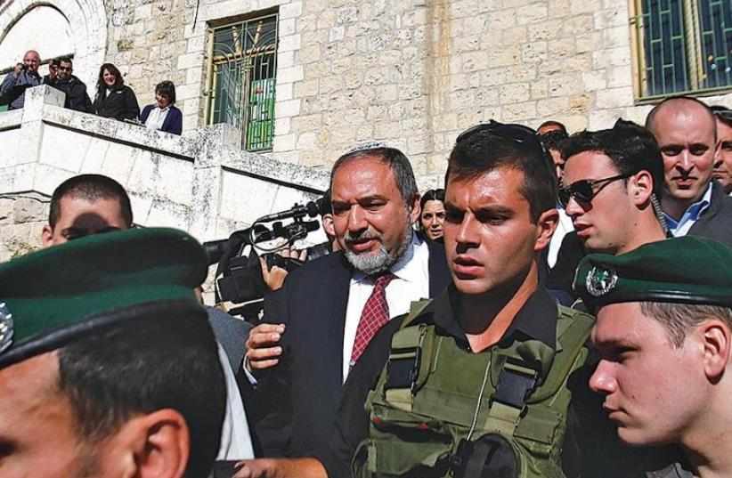 THEN-FOREIGN MINISTER Avigdor Liberman visits Hebron in January 2013 (photo credit: REUTERS)