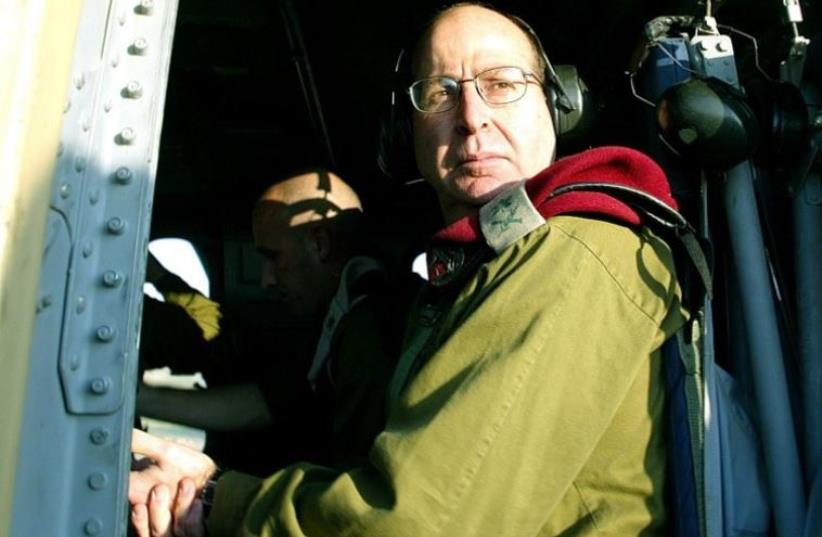 Then-chief of staff Moshe Yaalon is seen aboard a Black Hawk helicopter in 2004 (photo credit: AFP PHOTO)