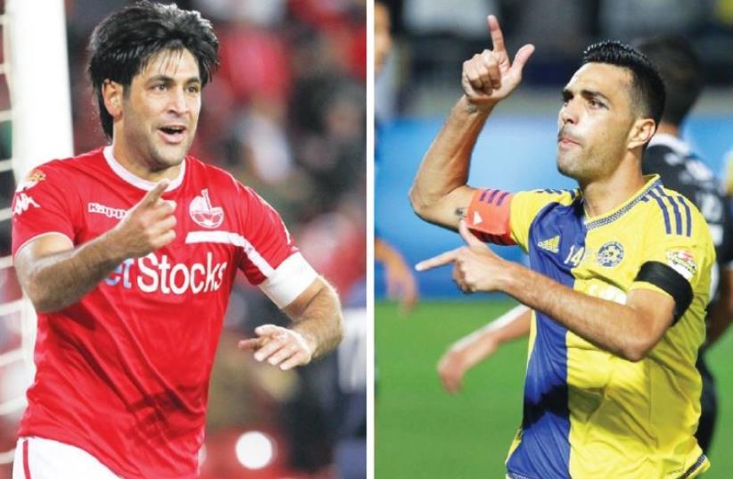 Hapoel Beersheba captain Elyaniv Barda (left) and Maccabi Tel Aviv captain Eran Zahavi (photo credit: DANNY MARON)