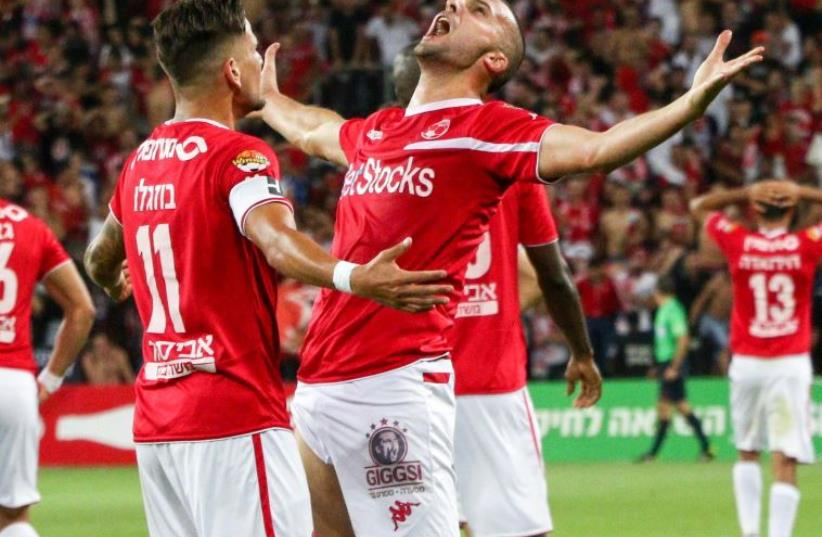 Hapoel Beersheba striker Ben Sahar (right) and teammate Maor Buzaglo, who both scored last night, celebrate the club's first Premier League championship in 40 years. (photo credit: DANNY MARON)