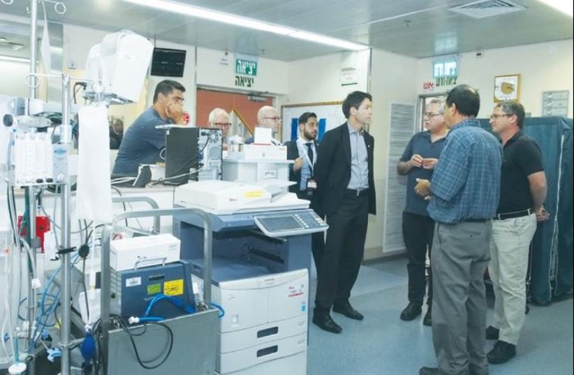 ONTARIO HEALTH MINISTER Dr. Eric Hoskins (center) visits Wolfson Medical Center in Holon last week for a close up look at its famed Save a Child's Heart program. (photo credit: SACH)