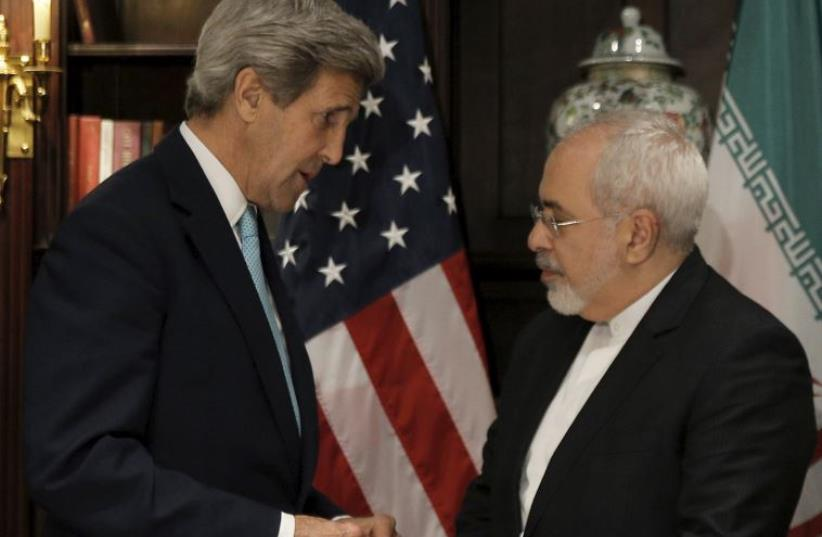 US Secretary of State John Kerry (L) meets with Iran's foreign minister, Mohammad Javad Zarif, in Manhattan (photo credit: REUTERS)