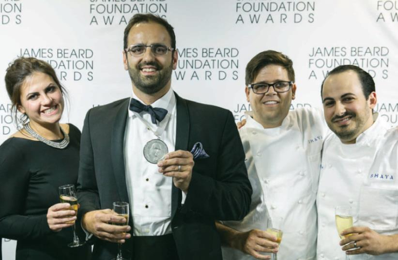Alon Shaya (center) celebrates his win at the James Beard awards ceremony in Chicago earlier this month. (photo credit: GALDONES PHOTOGRAPHY/JBF)