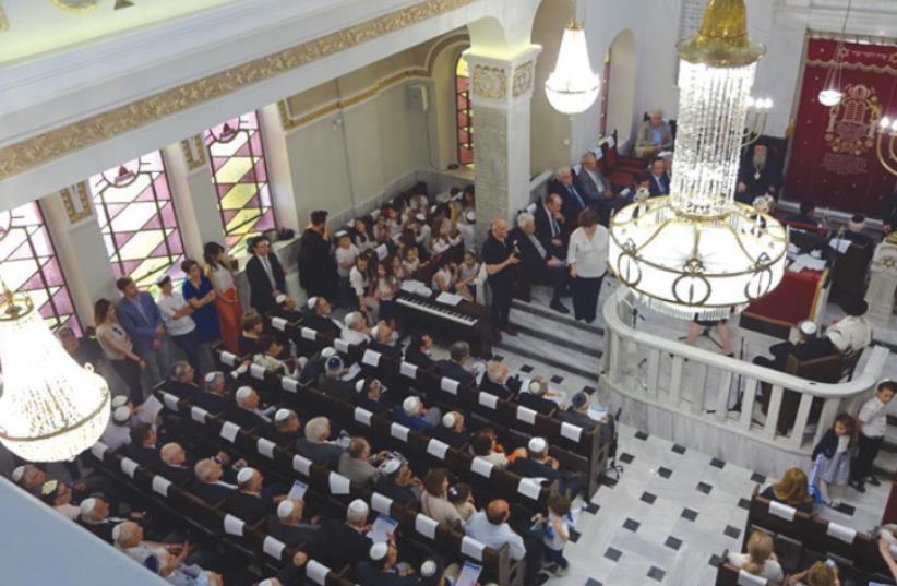 CONGREGANTS GATHER at the historic Salonika Synagogue (photo credit: Courtesy)