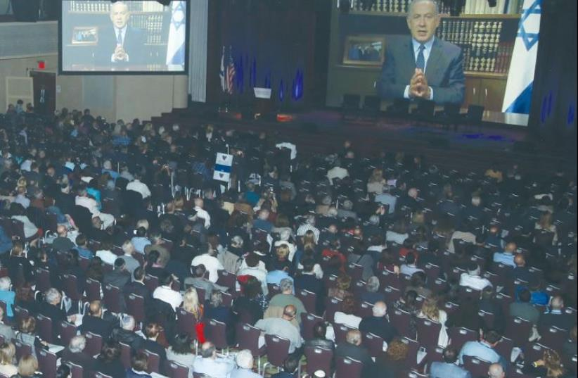 ATTENDEES AT The Jerusalem Post's fifth annual conference in New York listen to a pre-recorded address from Prime Minister Benjamin Netanyahu yesterday. (photo credit: MARC ISRAEL SELLEM/THE JERUSALEM POST)