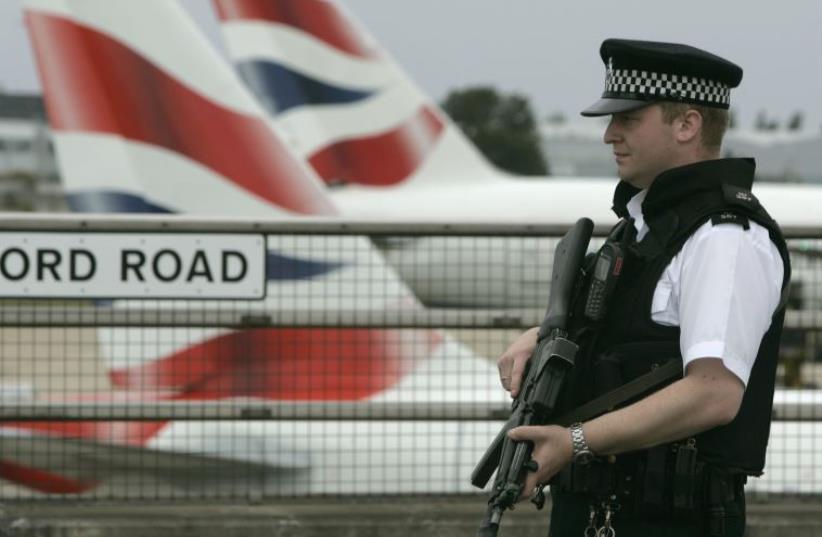 An armed policeman patrols Heathrow Airport, London (photo credit: REUTERS)