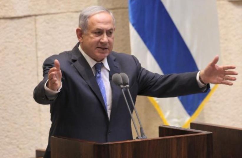 Prime Minister Benjamin Netanyahu addresses the Knesset in Jerusalem (photo credit: AFP PHOTO)