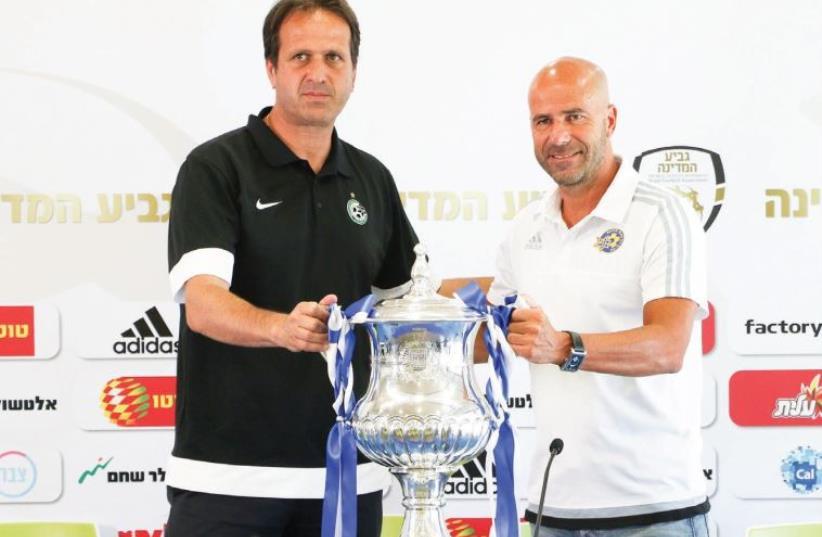 Maccabi Tel Aviv coach Peter Bosz (right), and Maccabi Haifa coach Roni Levy (photo credit: DANNY MARON)