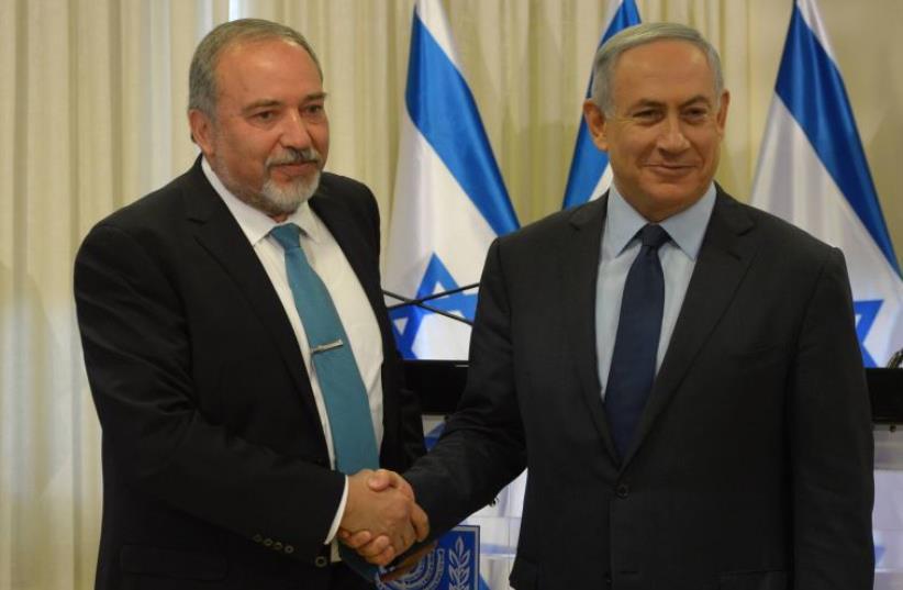Netanyahu and Liberman (photo credit: AMOS BEN GERSHOM, GPO)