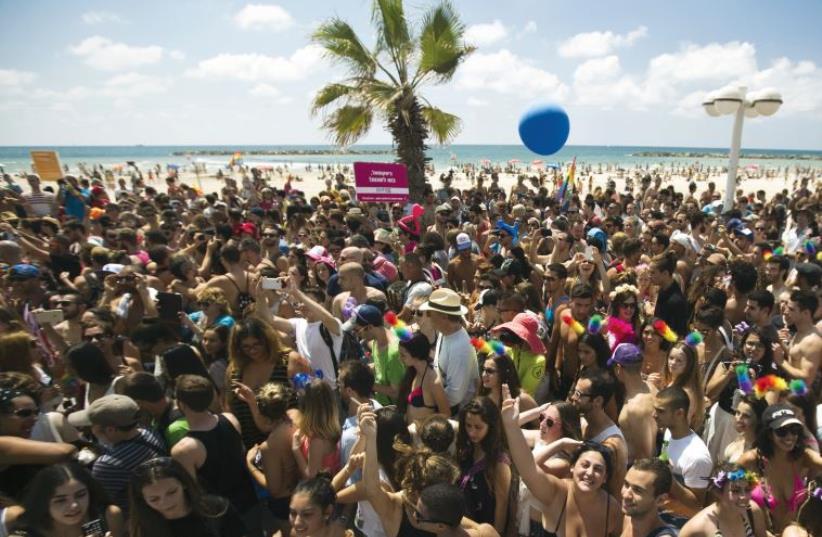 Crowds gather to celebrate Pride in Tel Aviv (photo credit: REUTERS)