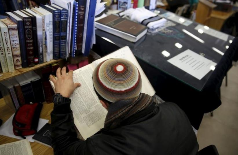 A student reads during a lesson at the Bnei David academy in the West Bank Jewish settlement of Eli (photo credit: REUTERS)