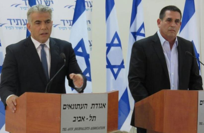 Yesh Atid leader Yair Lapid (L) and the party's newest member Yoav Segalovitz, May 29. 2016 (photo credit: YESH ATID)