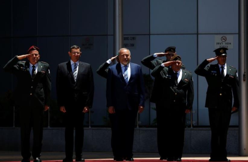 Avigdor Liberman reviews an honour guard during a welcoming ceremony at the Defence Ministry in Tel Aviv, Israel May 31, 2016 (photo credit: REUTERS)