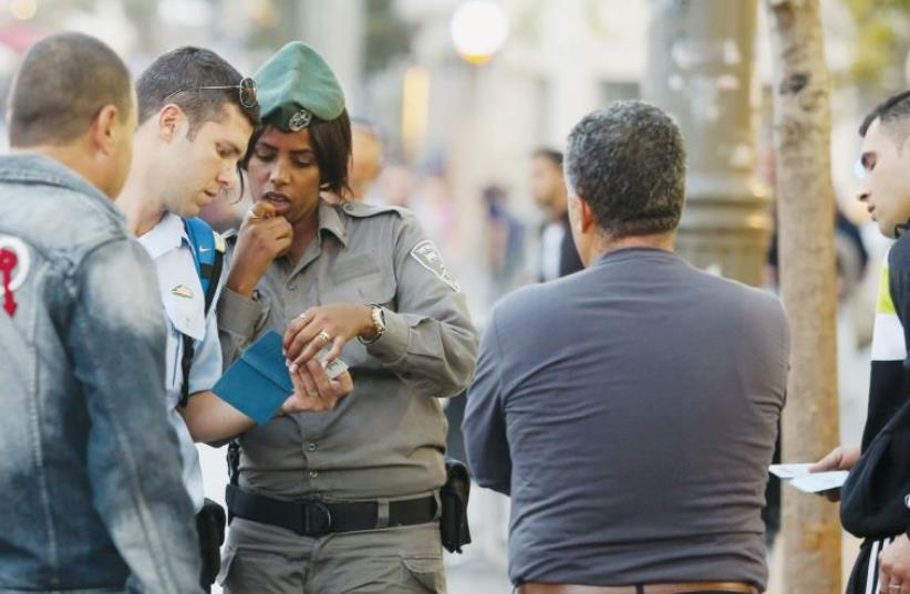 Police check the IDs of Arab men on Jaffa Road in Jerusalem (photo credit: MARC ISRAEL SELLEM)