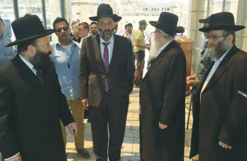 VISITING THE KOTEL Monday are, from left, Rabbi of the Western Wall Shmuel Rabinowitz, Interior Minister Arye Deri, Health Minister Ya'acov Litzman and MK Moshe Gafni (photo credit: SHAS)