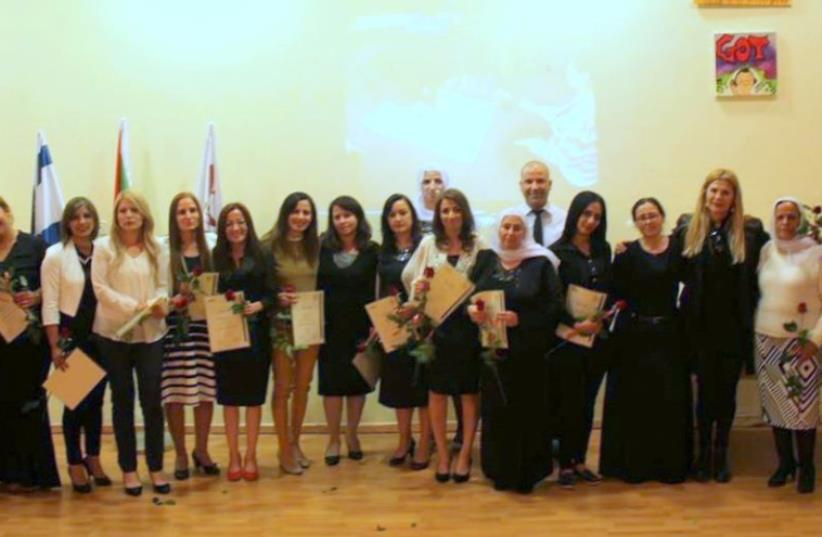 In the first scene - graduates of course instructors  finished getting certificats s (photo credit: LEAL FARHAT.)