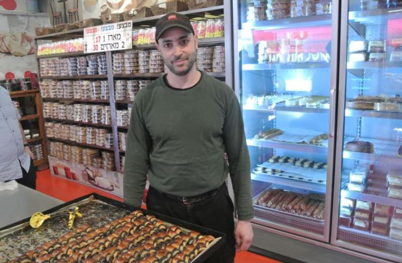 Itzik Ozarko, the owner of Marzipan bake shop in Machane Yehuda market, Jerusalem. Known for chocolate rugelach (photo credit: CHRISTINA GAROFALO/FLICKR)