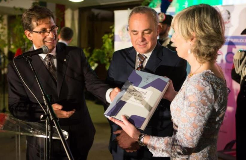 Ambassador Talo, Minister Steinitz, Minister Giannini with copy of Talmud (photo credit: ALEX PERGAMENT)