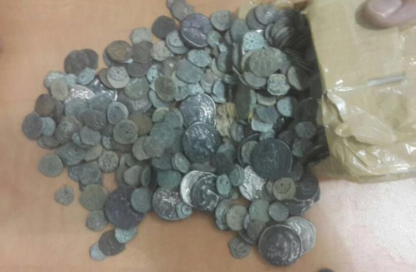 A driver for the Norwegian ebassy was arrested after attempting to steal at least 10 kilograms of ancient coins and figurines   (photo credit: CUSTOMS AUTHORITY)