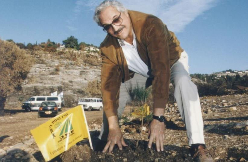 'A LOT of people my age are retired and I have no intentions of doing that. I'm continuing to act and do my concerts and keep doing more of the same,' says Emmy-award wining actor Hal Linden, seen here planting a tree in the Judean Hills. (photo credit: JNF)