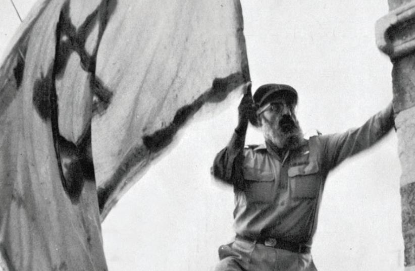 Almost singlehanded liberation: IDF chief rabbi Shlomo Goren waves the flag in Hebron (photo credit: JEWISH COMMUNITY OF HEBRON)