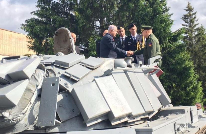 Prime Minister Benjamin Netanyahu at a ceremony near Moscow in which Russia returned an Israeli tank used in the First Lebanon War (photo credit: Courtesy)