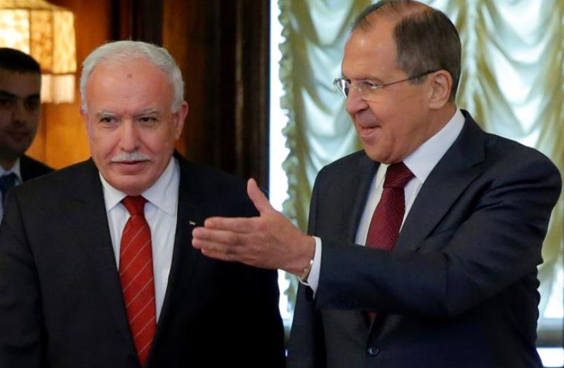 Russian Foreign Minister Sergei Lavrov (R) shows the way to his PA counterpart Riyad al-Maliki during a meeting in Moscow, Russia June 8, 2016.  (photo credit: REUTERS/MAXIM SHEMETOV)